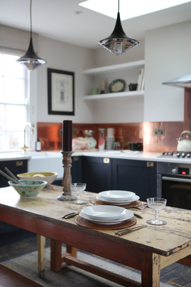Example of a mountain style dining room design in London