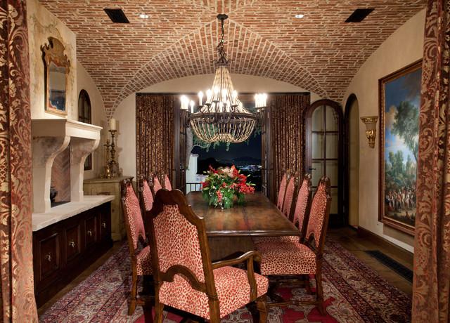 Tuscan dark wood floor enclosed dining room photo in Phoenix with beige walls