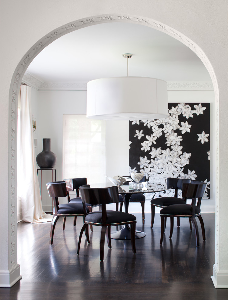Example of a trendy dining room design in Denver with white walls