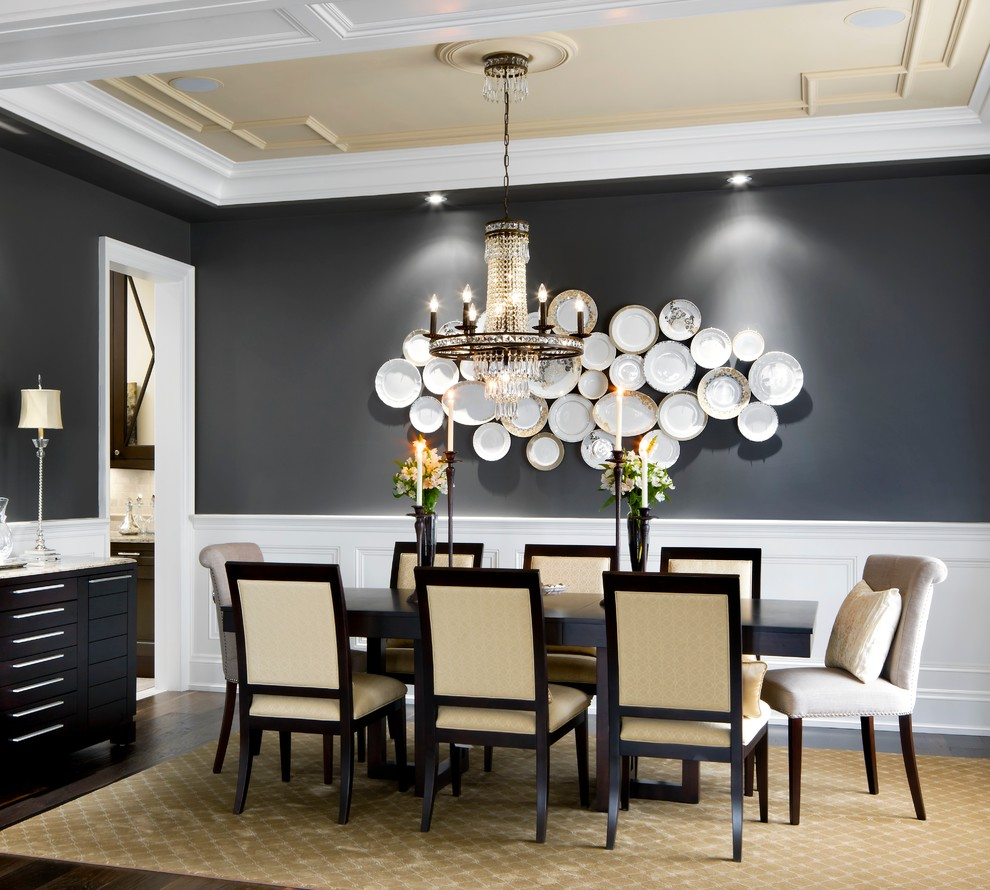 Inspiration for a timeless dark wood floor enclosed dining room remodel in Toronto with black walls