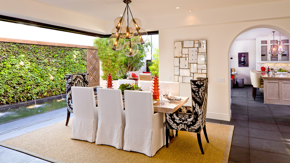 Inspiration for a mid-sized mediterranean slate floor dining room remodel in Orange County with white walls