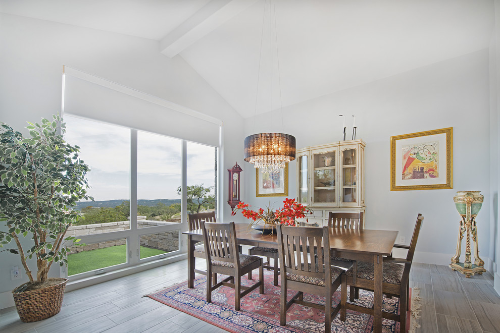 Example of a transitional dining room design in Austin with gray walls