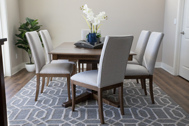 Example of a mid-sized transitional vinyl floor and brown floor kitchen/dining room combo design in Other with beige walls