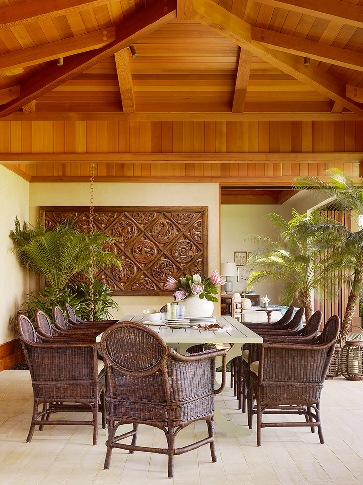 Inspiration for a tropical light wood floor dining room remodel in Hawaii with beige walls