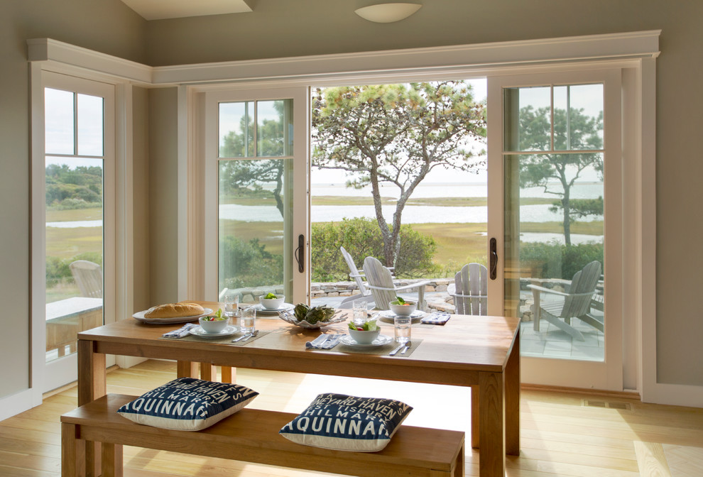 Inspiration for a mid-sized coastal light wood floor and brown floor enclosed dining room remodel in Boston with gray walls and no fireplace