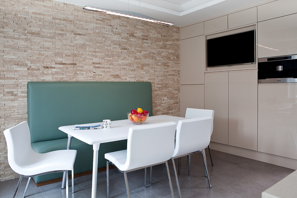 Trendy kitchen/dining room combo photo in London