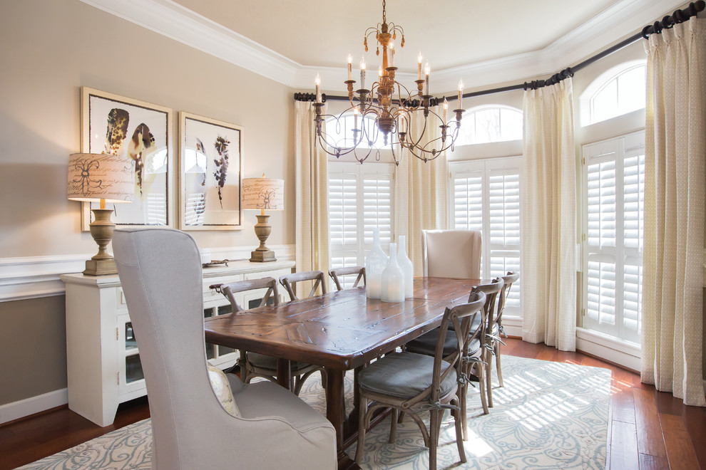 Elegant medium tone wood floor enclosed dining room photo in Dallas with beige walls and no fireplace