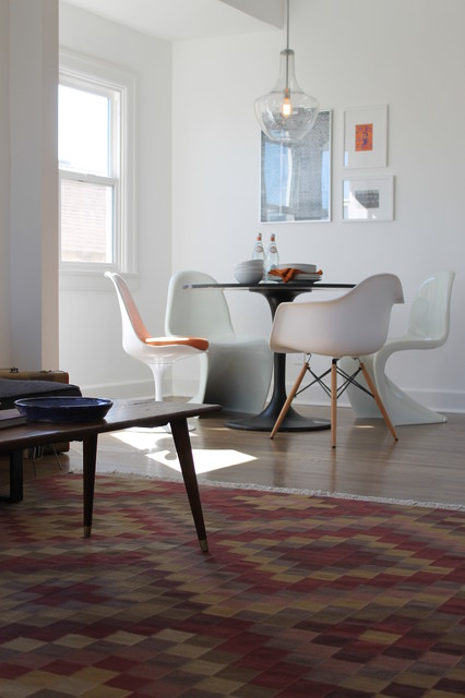 kilim rug and iconic mcm chairs modern dining room
