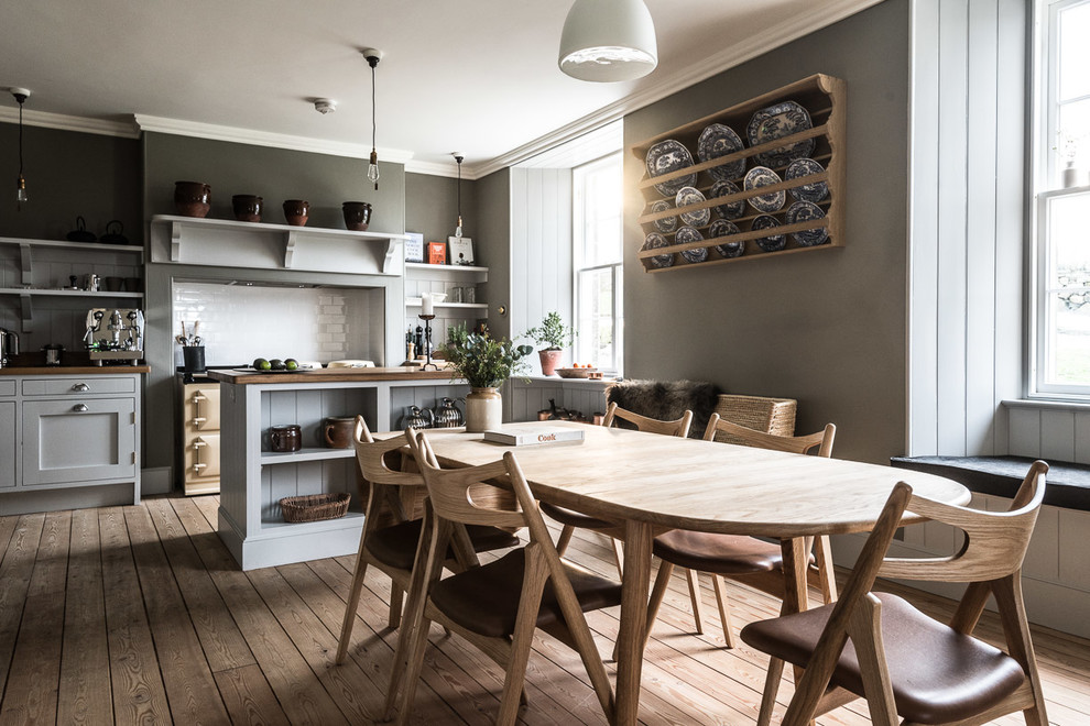 Example of a farmhouse light wood floor kitchen/dining room combo design in Edinburgh with gray walls