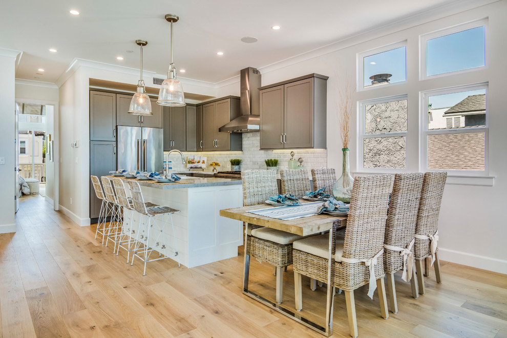 Kitchen/dining room combo - mid-sized coastal light wood floor kitchen/dining room combo idea in Los Angeles with white walls