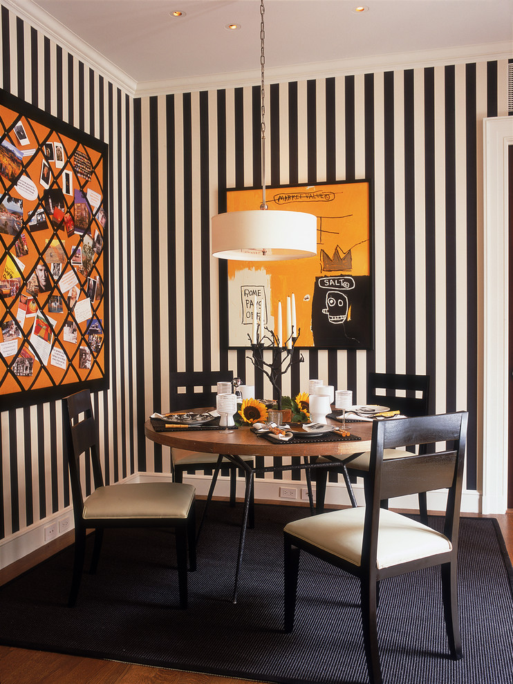 Dining room - contemporary dining room idea in Chicago with multicolored walls