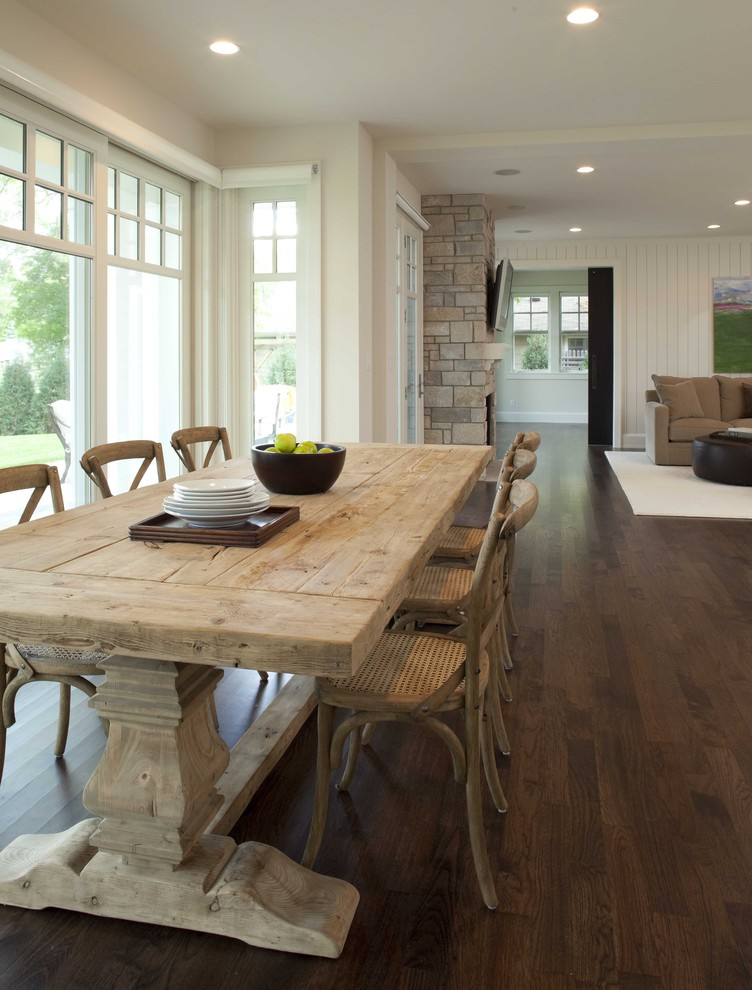 Country dark wood floor and brown floor great room photo in Minneapolis with white walls