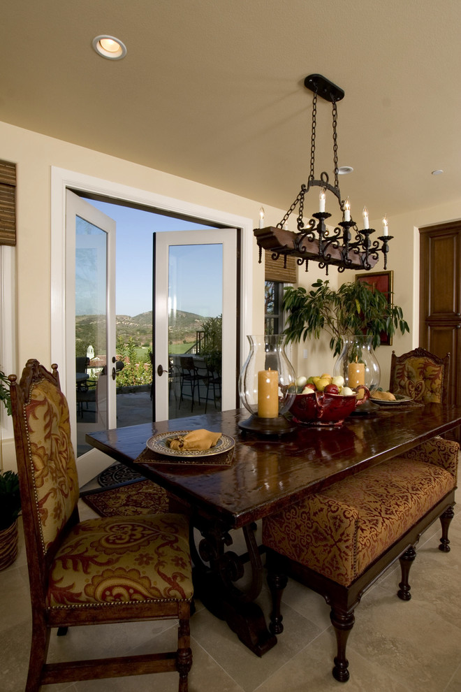 Inspiration for a timeless dining room remodel in Orange County with beige walls