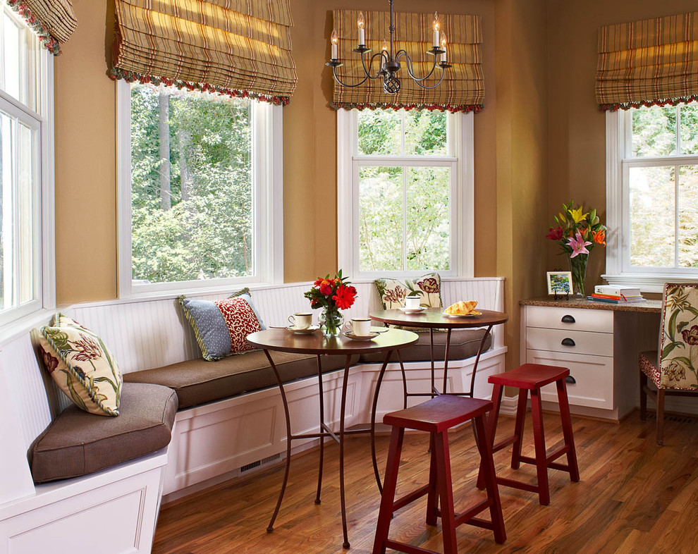 Kitchen/dining room combo - mid-sized traditional medium tone wood floor kitchen/dining room combo idea in Raleigh
