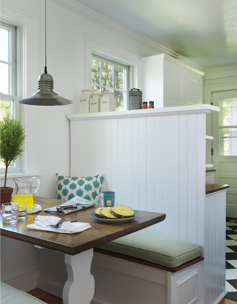 Inspiration for a coastal kitchen/dining room combo remodel in Providence with white walls
