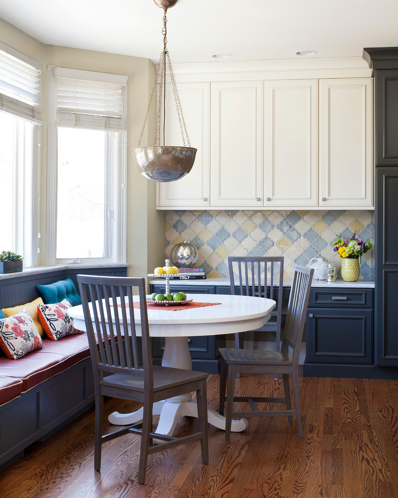 Inspiration for a mid-sized timeless dark wood floor dining room remodel in Denver with white walls