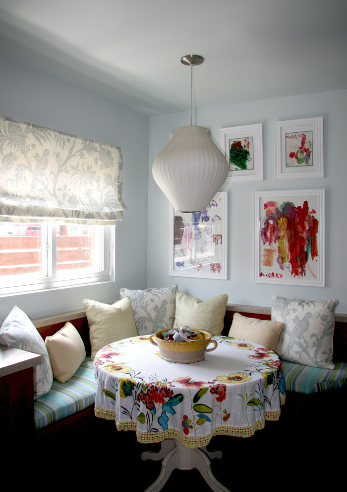 Eclectic dining room photo in Los Angeles with blue walls