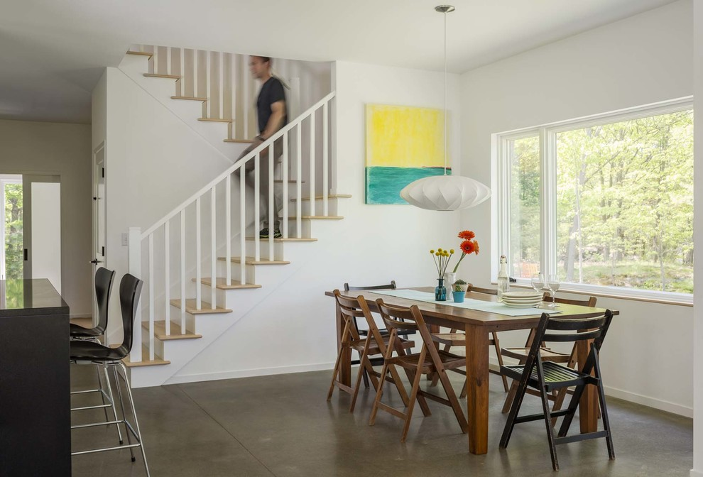 Great room - mid-sized contemporary concrete floor and gray floor great room idea in Burlington with white walls