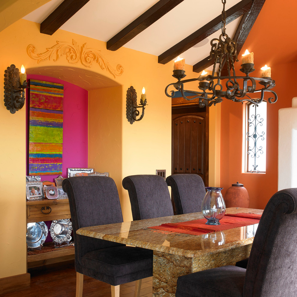 Inspiration for a southwestern dining room remodel in Vancouver with yellow walls
