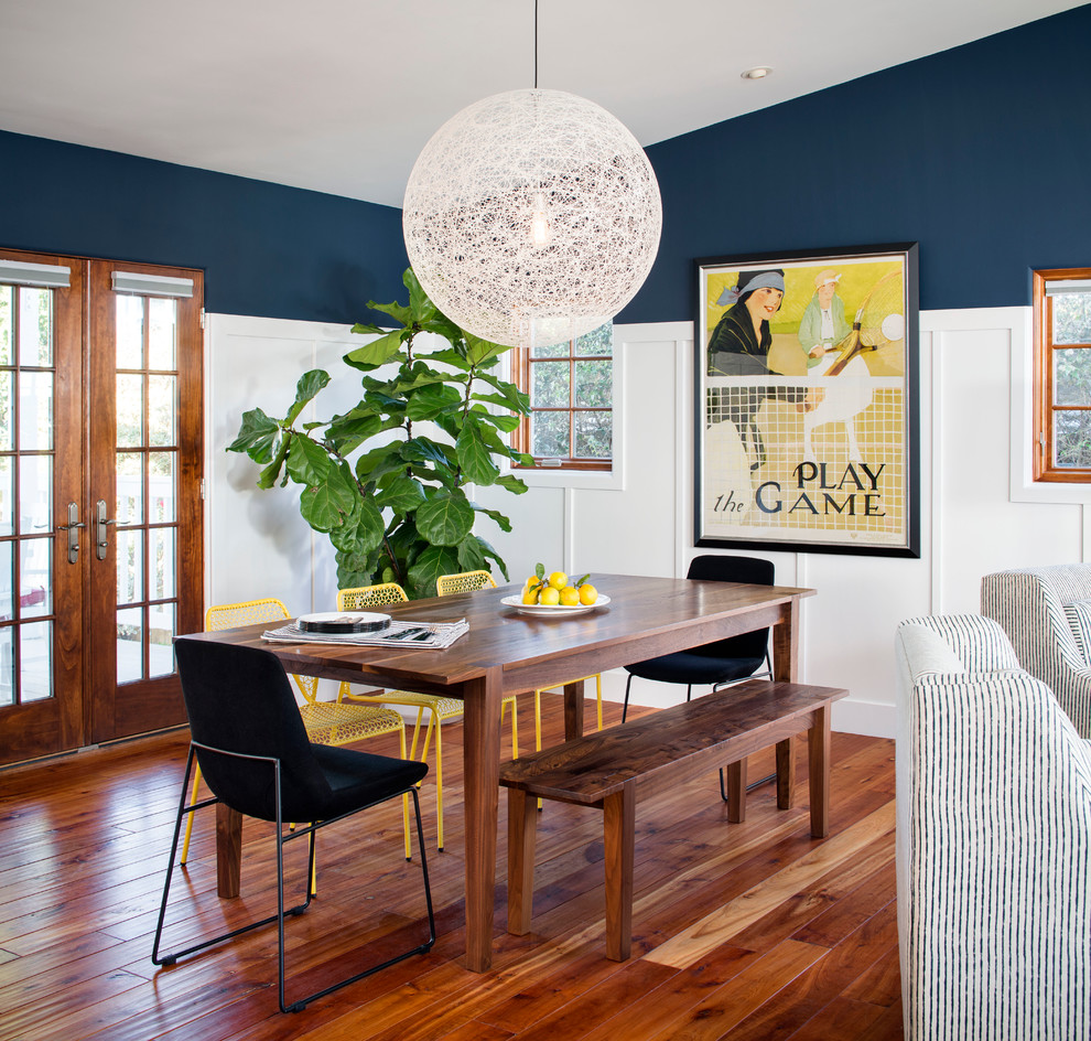 Inspiration for a mid-sized coastal medium tone wood floor great room remodel in San Francisco with blue walls and no fireplace