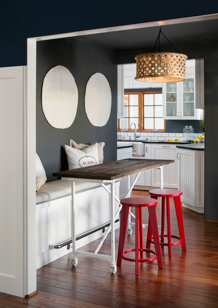 Inspiration for a mid-sized coastal medium tone wood floor kitchen/dining room combo remodel in San Francisco with gray walls and no fireplace