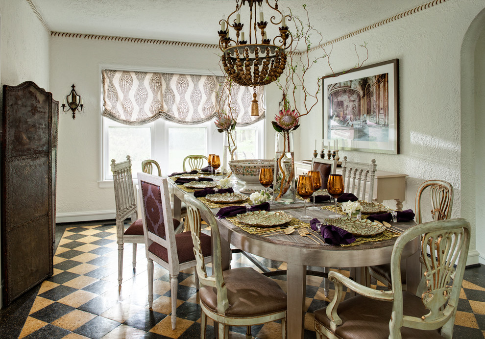 Example of a classic dining room design in Chicago with white walls