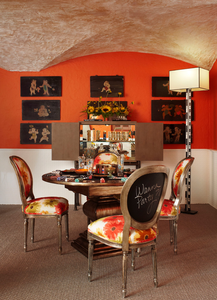 Dining room - eclectic carpeted dining room idea in Chicago with red walls