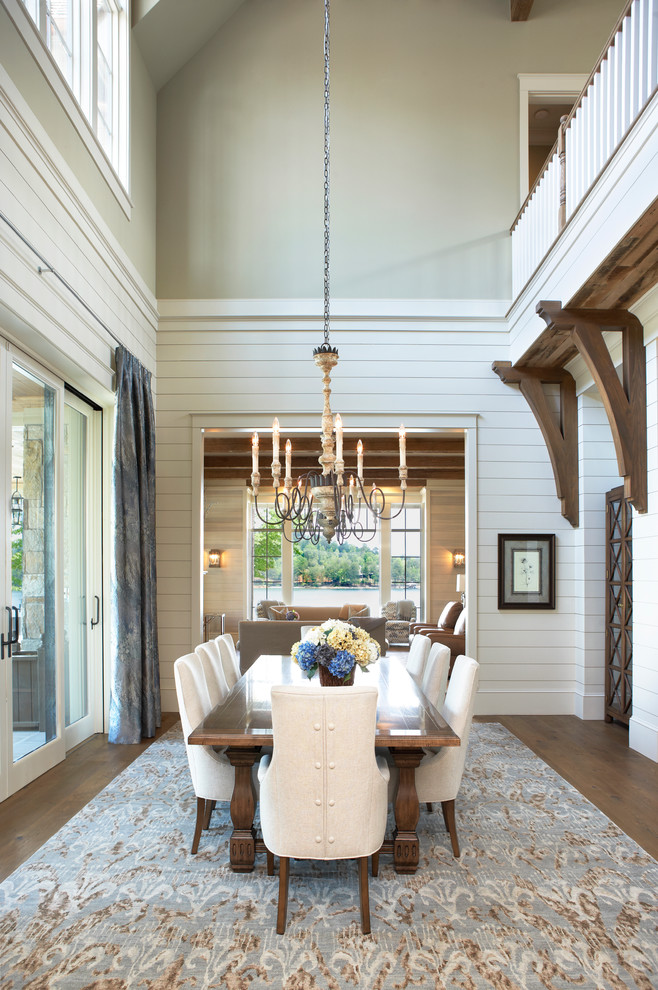 Inspiration for a timeless medium tone wood floor dining room remodel in Other with white walls