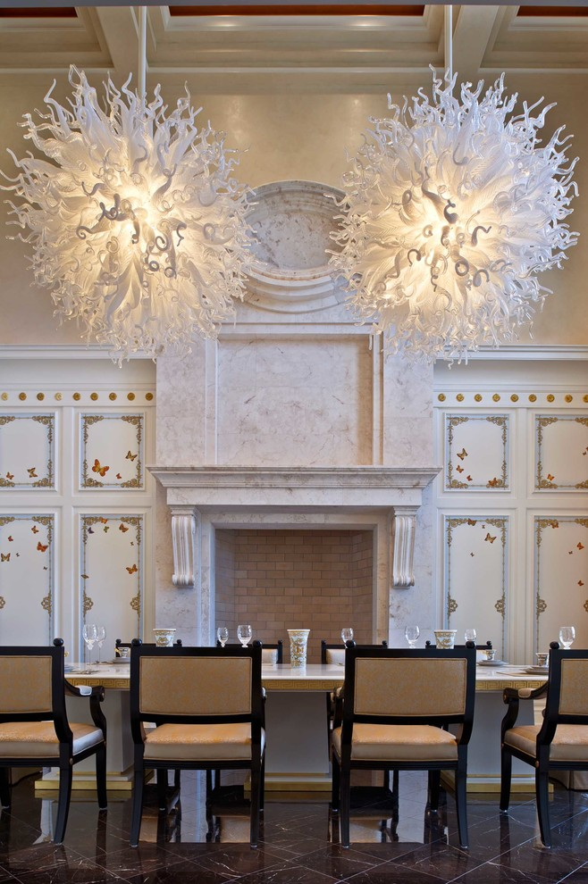 Inspiration for a mediterranean dining room remodel in Orlando with beige walls, a standard fireplace and a stone fireplace