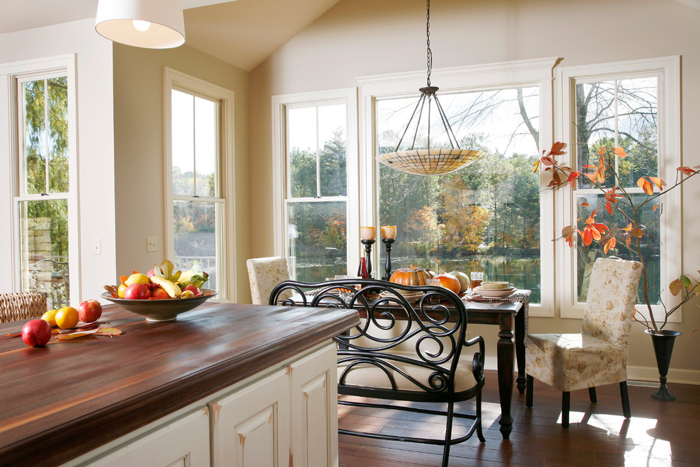 Kitchen/dining room combo - mid-sized traditional dark wood floor and brown floor kitchen/dining room combo idea in Grand Rapids with beige walls and no fireplace