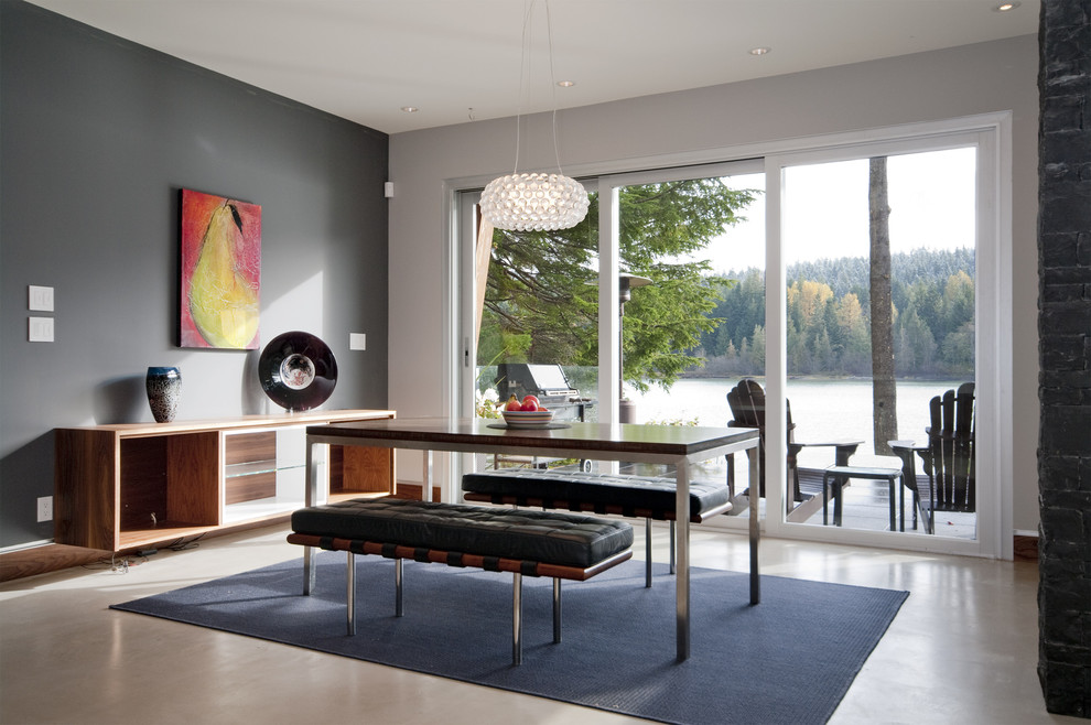 Inspiration for a contemporary dining room remodel in Vancouver with gray walls