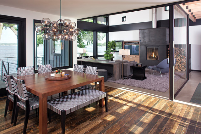 Inspiration for a contemporary medium tone wood floor great room remodel in Minneapolis with white walls