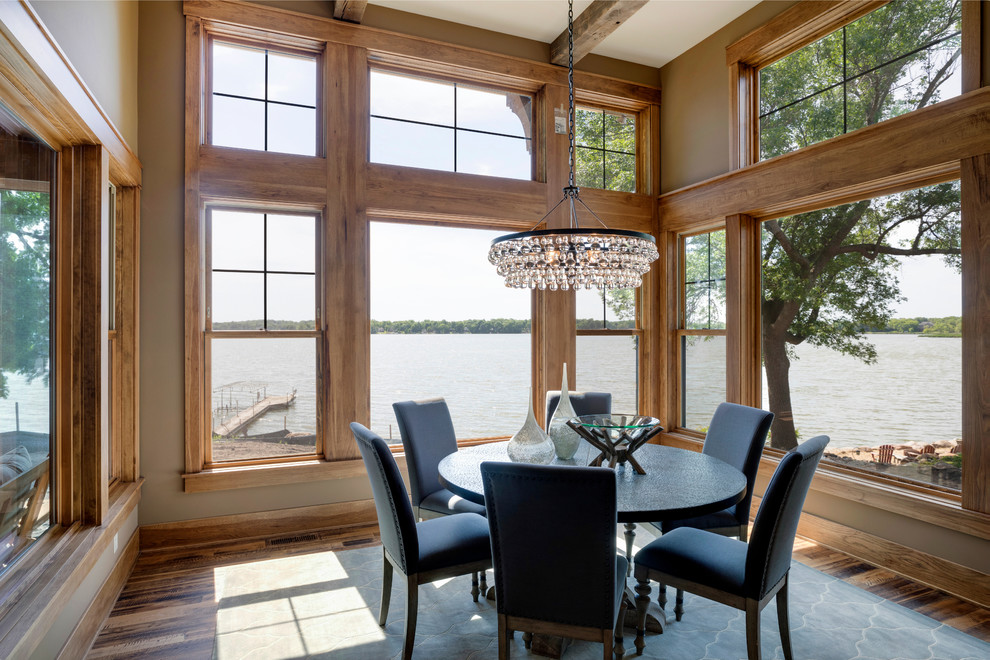 Example of a large mountain style medium tone wood floor and brown floor kitchen/dining room combo design in Minneapolis with beige walls
