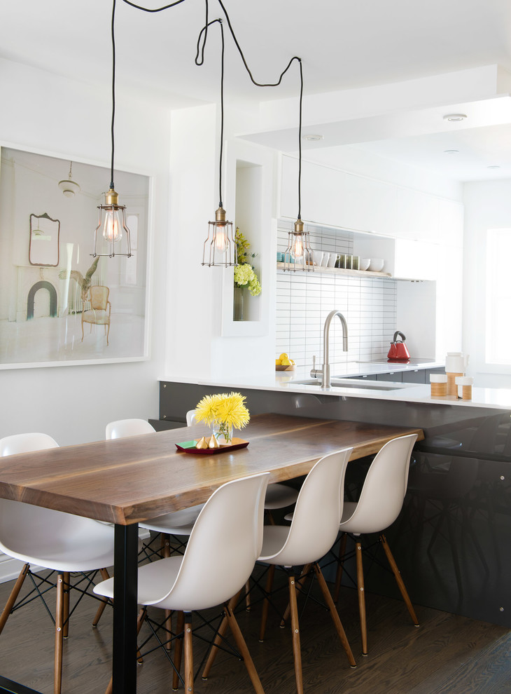 Inspiration for a contemporary dark wood floor and brown floor kitchen/dining room combo remodel in Toronto