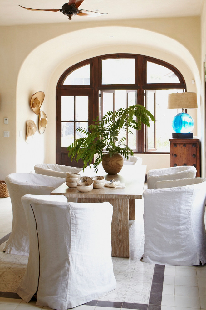 Inspiration for a mediterranean dining room remodel in Other with beige walls