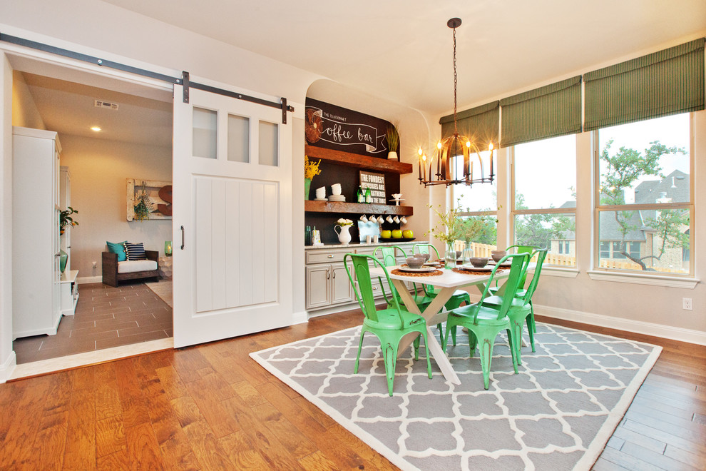 Inspiration for a farmhouse medium tone wood floor dining room remodel in Austin