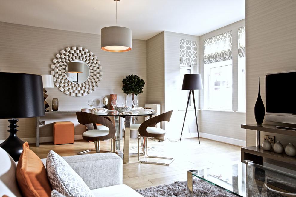 Trendy light wood floor great room photo in Edinburgh with beige walls