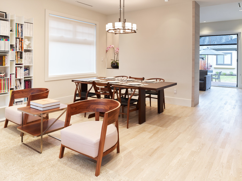 Example of a small trendy light wood floor dining room design in Vancouver with beige walls and no fireplace