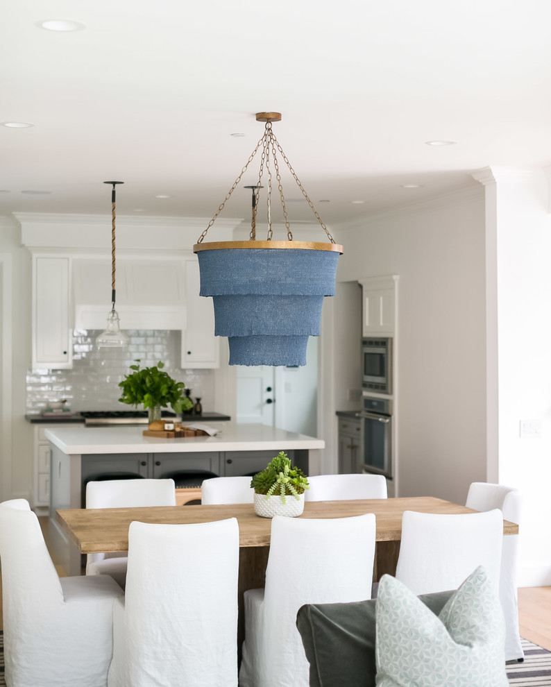 Kitchen/dining room combo - mid-sized coastal light wood floor kitchen/dining room combo idea in Orange County with white walls