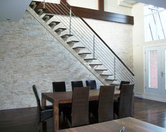Light Stone Accent Wall Stiarcase  dining room