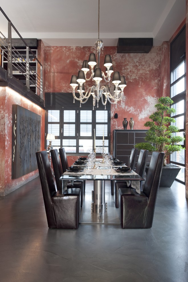 Example of a large urban concrete floor dining room design in Milan with red walls