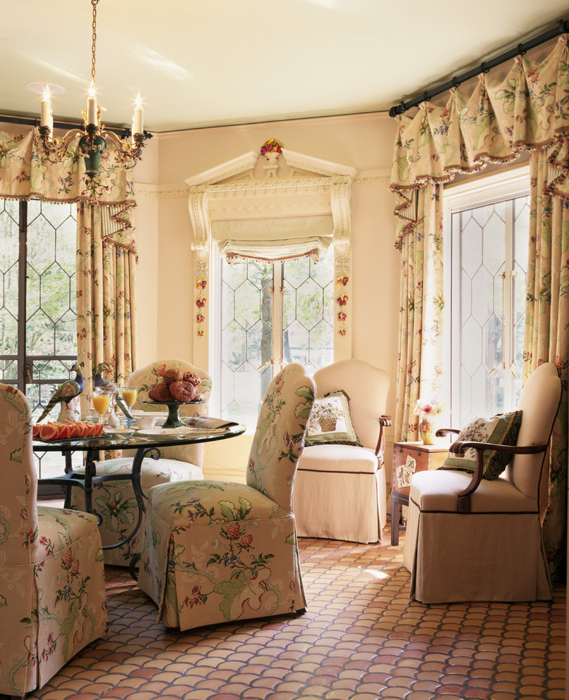French country terra-cotta tile dining room photo in Chicago with pink walls