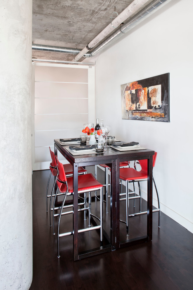 Inspiration for a mid-sized industrial dark wood floor great room remodel in Toronto with white walls