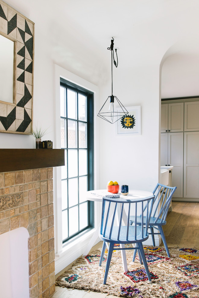 Tuscan light wood floor great room photo in Los Angeles with white walls