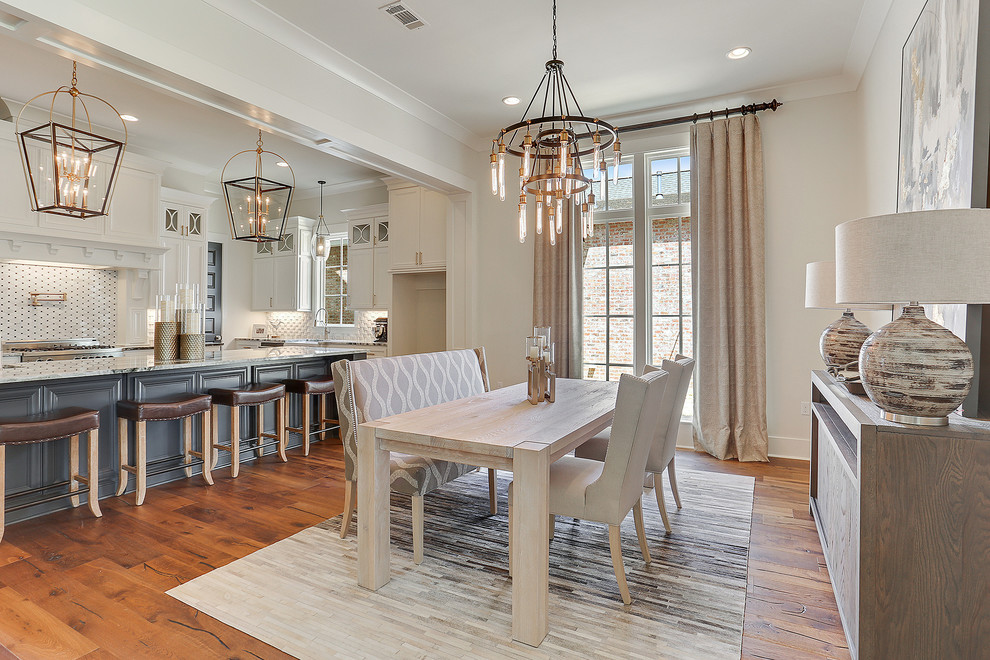 Inspiration for a mid-sized country dark wood floor and brown floor great room remodel in New Orleans with gray walls and no fireplace