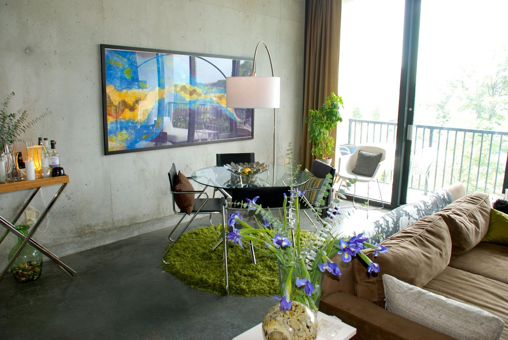 Example of an eclectic concrete floor dining room design in Atlanta