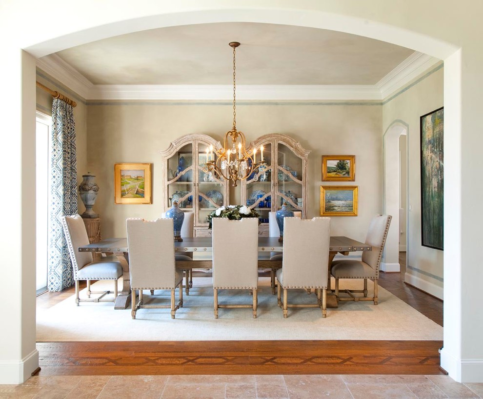 Example of a classic medium tone wood floor enclosed dining room design in Dallas with beige walls