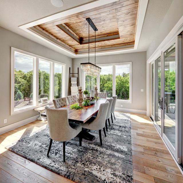 Dining room - farmhouse beige floor and medium tone wood floor dining room idea in Kansas City with gray walls