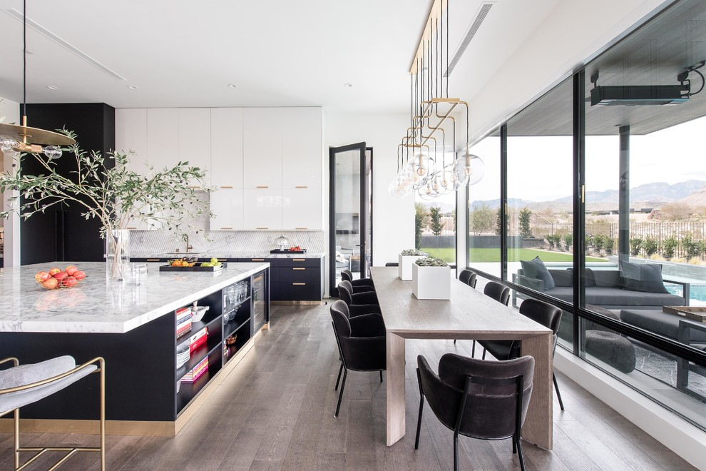 Kitchen/dining room combo - contemporary dark wood floor and blue floor kitchen/dining room combo idea in Las Vegas with white walls and no fireplace