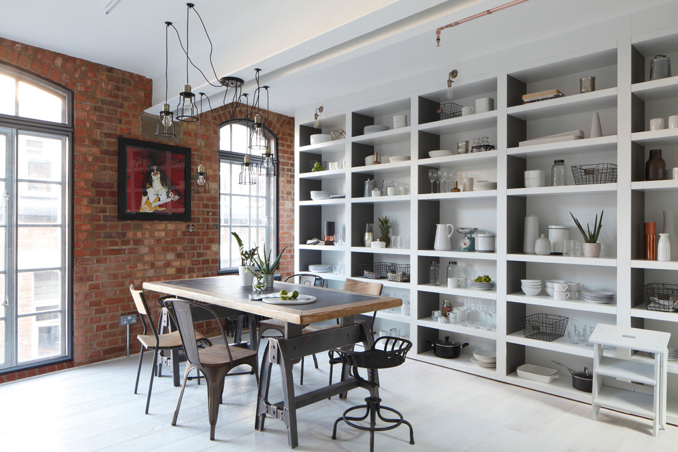 Inspiration for a large industrial painted wood floor dining room remodel in London